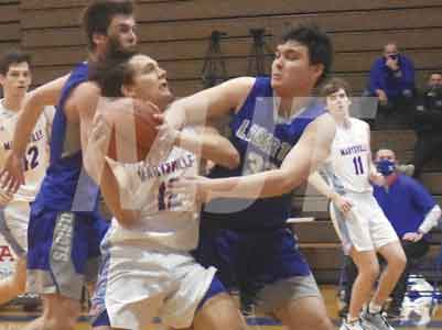 MHS cagers fall to Liberty during first game back from long layoff